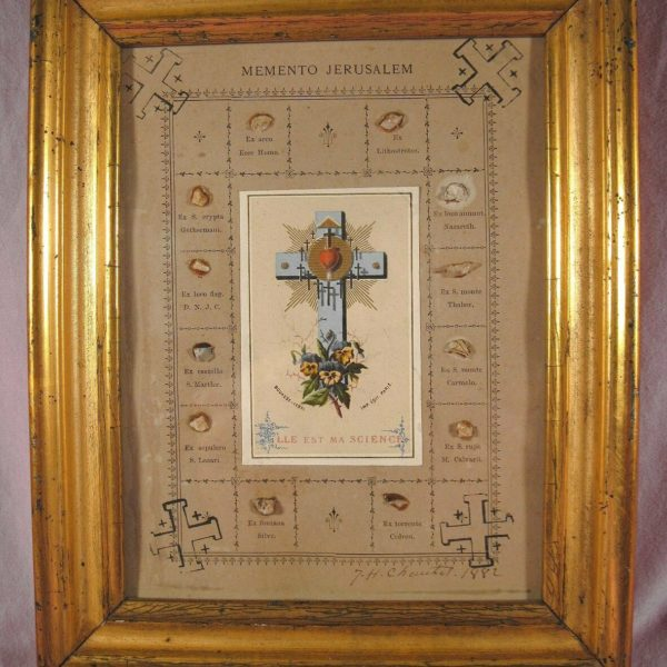 ANTIQUE FRAMED DOCUMENT WITH 12 RELICS FROM THE HOLY LAND - DATED 1882.