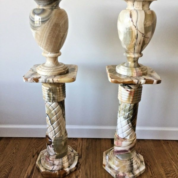 Pair of Variegated Marble Urns and Matching Pedestals